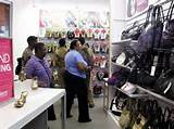 Shoppers scrutinise prices at Payless ShoeSource, which recently ...